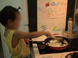 Girl stir frying