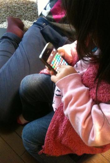 Girl playing game on smartphone